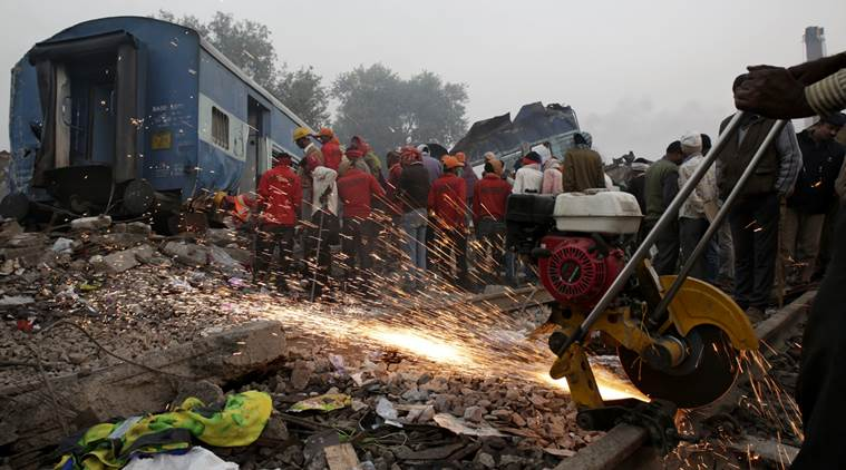 Rescuers search among the debris after 14 coaches of an overnight passenger train rolled off the track near Pukhrayan village in Kanpur Dehat district of the northern Indian state of Uttar Pradesh, India, Monday, Nov. 21, 2016.